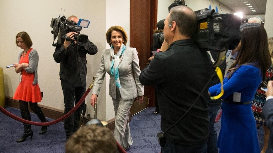 House Minority Leader Nancy Pelosi of Calif. arrives on Capitol Hill in Washington, Tuesday, April 14, 2015, for  a House Democratic Caucus meeting  to discuss the Iran nuclear deal with Secretary of State John Kerry. Kerry, who played a leading role in getting a framework agreement with Iran last month, personally pleaded with House Republicans and Democrats on Monday to give the Obama administration more time and room to negotiate a final deal. Kerry met in a closed-door session with members of the House and was to meet with senators on Tuesday before the committee debates the bill. (AP Photo/Andrew Harnik)