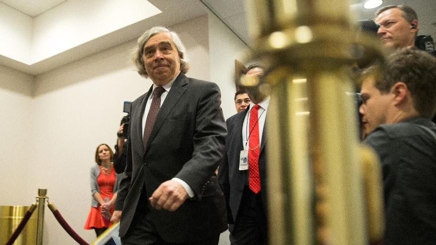 Energy Secretary Ernest Moniz arrives on Capitol Hill in Washington, Tuesday, April 14, 2015, for a meeting of the House Democratic Caucus where Secretary of State John Kerry will ask members of Congress to give the Obama administration more time and room to negotiate a final nuclear deal with Iran. Kerry, who played a leading role in getting a framework agreement with Iran last month, personally pleaded with House Republicans and Democrats on Monday to give the Obama administration more time and room to negotiate a final deal. Kerry met in a closed-door session with members of the House and was to meet with senators on Tuesday before the committee debates the bill. (AP Photo/Andrew Harnik)