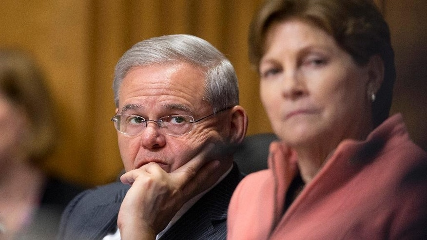 Senate Foreign Relations Committee members Sen. Robert Menendez, D-N.J., left, and Sen. Jeanne Shaheen, D-N.H., attend a Senate Foreign Relations Committee meeting on Capitol Hill in Washington, Tuesday, April 14, 2015, to debate and vote on the Iran Nuclear Agreement Review Act of 2015. A Senate panel has unanimously approved a bill that would give Congress a say about the emerging deal aimed at preventing Iran from developing nuclear weapons in exchange for sanctions relief. The Foreign Relations Committee voted 19-0. (AP Photo/Manuel Balce Ceneta)