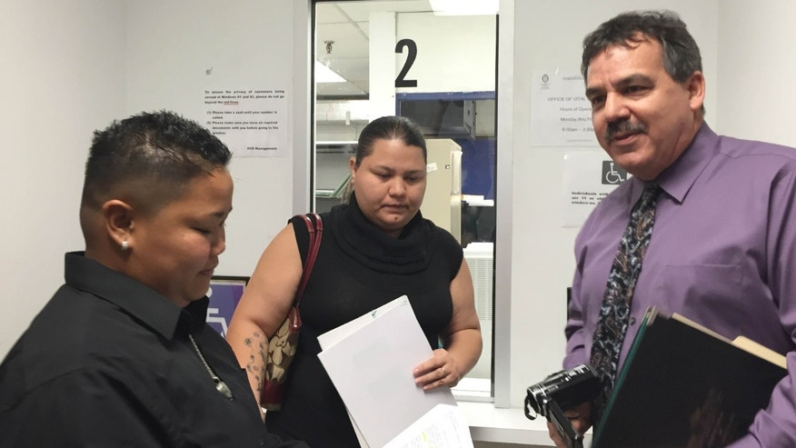 April 8, 2015: Same-sex couple Loretta M. Pangelinan, left, and Kathleen M. Aguero, both 28, react after they were turned away while attempting to apply for a marriage license at the Guam Department of Public Health and Social Services Office of Vital Statistics.