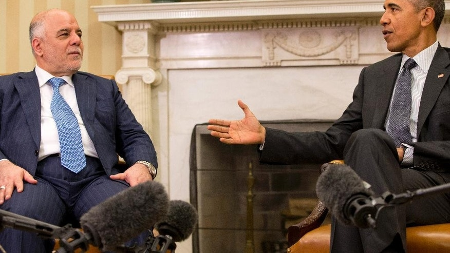 President Barack Obama speaks during his meeting with Iraqi Prime Minister Haider Al-Abadi in the Oval Office of the White House in Washington, Tuesday, April 14, 2015. The Prime Minister is visiting to discuss U.S.-Iraq policy and the fight against the IS group. (AP Photo/Jacquelyn Martin)