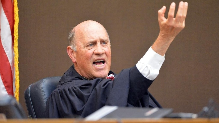 "Fulton County Superior Court Judge Jerry Baxter describes how the three former SRT directors were at the top of the chain during sentencing on Tuesday, April 14, 2015, in Atlanta. All but one of 10 former Atlanta public school educators convicted in a widespread conspiracy to inflate student scores on standardized tests were sentenced to jail time Tuesday. Baxter called the cheating scandal ""the sickest thing that's ever happened in this town."" (Kent D. Johnson/Atlanta Journal-Constitution via AP, Pool)"