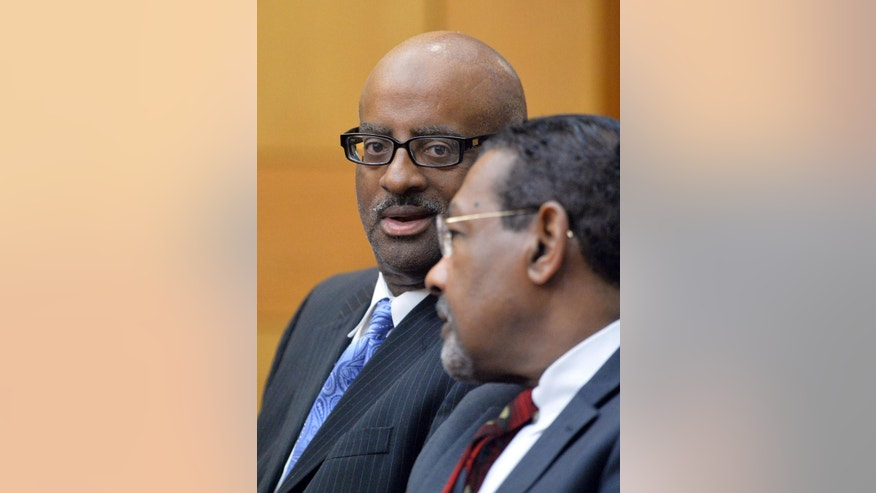 "Former Atlanta public school SRT Director Michael Pitts talks with his defense attorney George Lawson during sentencing on Tuesday, April 14, 2015 in Atlanta. All but one of 10 former Atlanta public school educators convicted in a widespread conspiracy to inflate student scores on standardized tests were sentenced to jail time Tuesday. Fulton County Superior Court Judge Jerry Baxter called the cheating scandal ""the sickest thing that's ever happened in this town.""  (Kent D. Johnson/Atlanta Journal-Constitution via AP, Pool)"