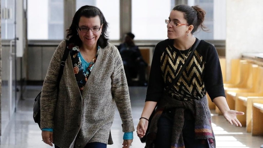 Rosemary Hernandez, left, and Becky Hernandez, the wife and daughter of Pedro Hernandez, arrive for court in New York, Wednesday, April 15, 2015.  Jurors have started deliberations in the case against Hernandez, accused of killing 6-year-old Etan Patz who vanished in 1979.   (AP Photo/Richard Drew)
