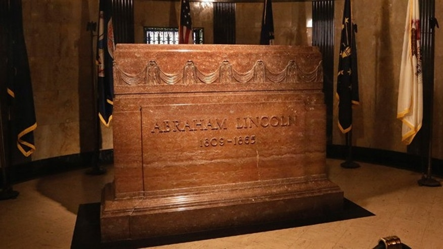 FILE - In this Tuesday, Nov. 19, 2013 file photo, a marker is seen over the burial site of Abraham Lincoln inside Lincoln's tomb within Oak Ridge Cemetery in Springfield, Ill. (AP Photo/Seth Perlman, File)