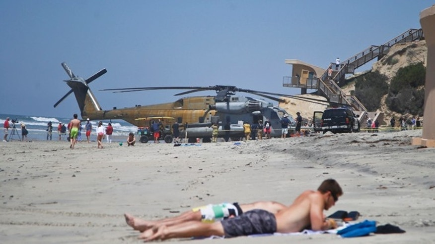 Apr. 15, 2015: A Marine Corps helicopter sits in the sand where it made an emergency landing in Solana Beach, Calif. (AP)