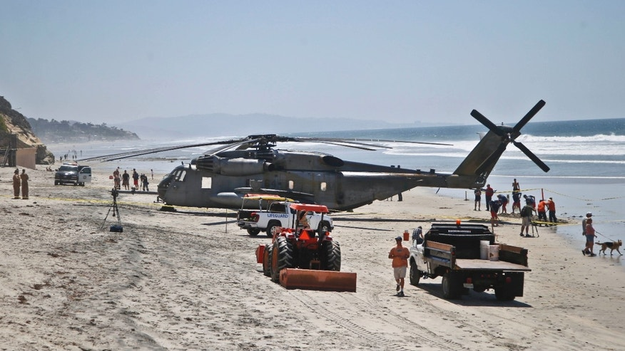 April 15, 2015: A Marine Corps helicopter sits in the sand where it made an emergency landing.