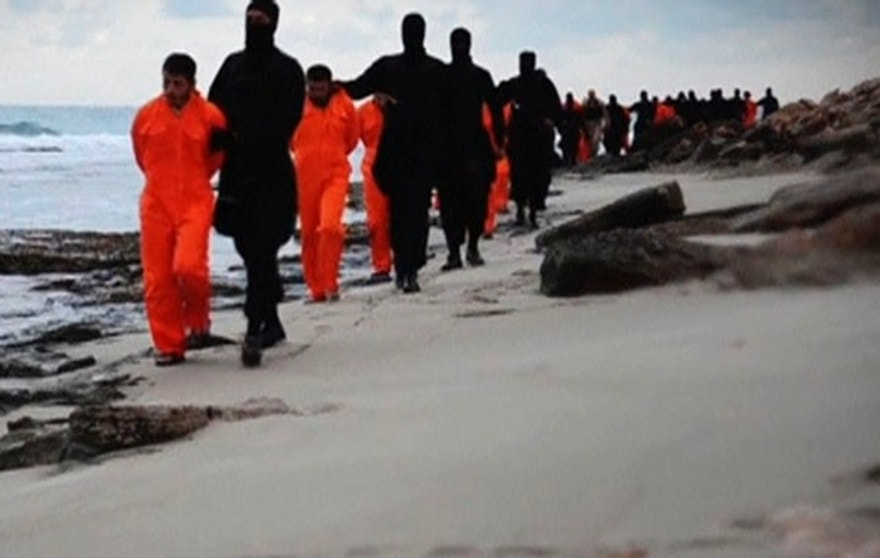 In this February video, which some experts believe was manipulated, ISIS fighters march poor Egyptian fisherman along the beach before beheading them. (Screengrab)