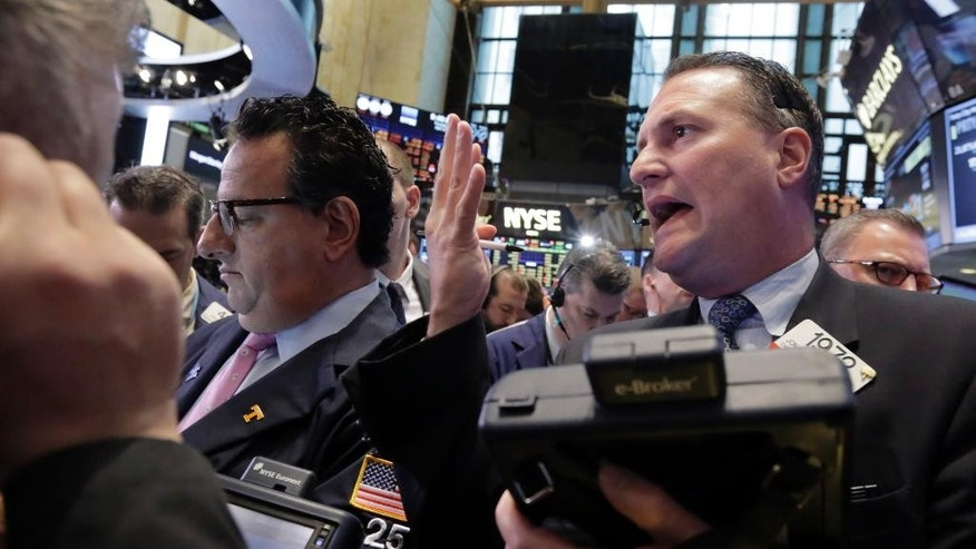 Trader Jonathan Corpina, right, works on the floor of the New York Stock Exchange, Thursday, April 16, 2015. U.S. stocks are heading lower as more big companies turn in earnings. (AP Photo/Richard Drew)