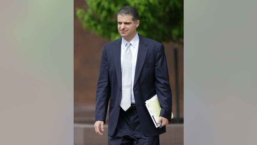 Christopher Joseph, attorney for Alexander E. Blair, leaves the federal court house in Topeka, Kan., Thursday, April 16, 2015. A judge decided Thursday to release Blair to his parents' custody, which is expected to happen by Monday. (AP Photo/Orlin Wagner)