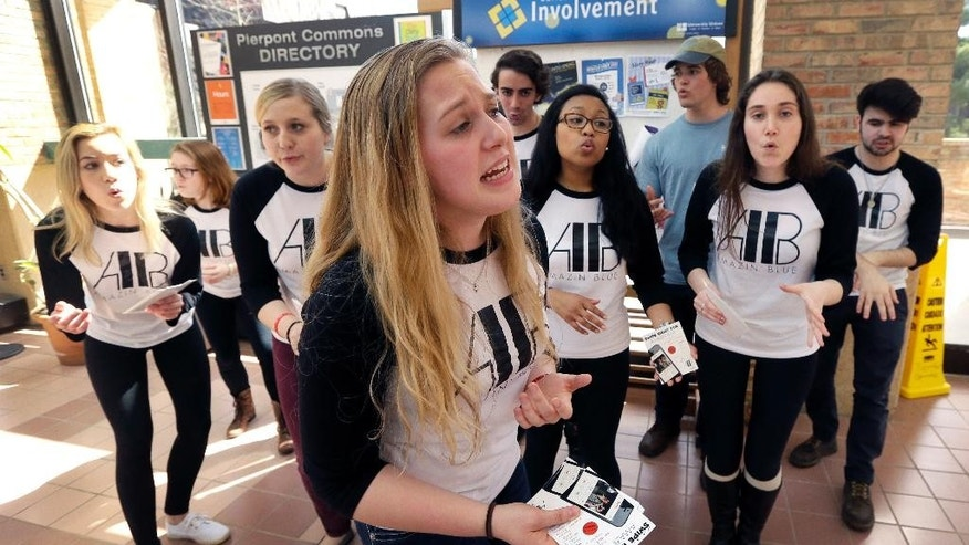In a photo from Friday, April 10, 2015, Abby Drumright sings with The Amazin' Blue, a A Cappella group, during a practice session at Pierpont commons in Ann Arbor, Mich. (AP Photo/Carlos Osorio)