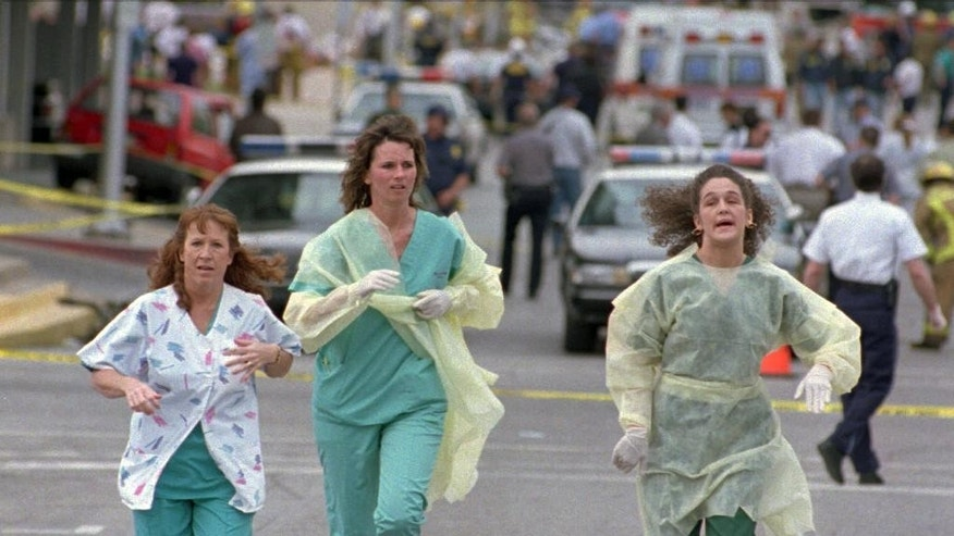 FILE - In this April 19, 1995 file photo, medical assistants, Janet Froehlich, left, Wilma Jackson and Kerri Albright run from the Alfred Murrah Federal Building after being told another bomb device had been found in Oklahoma City. The blast killed 168 people _ including 19 children _ injured hundreds more and caused hundreds of millions of dollars in damage to structures and vehicles in the downtown area. (AP Photo/David J. Phillip)