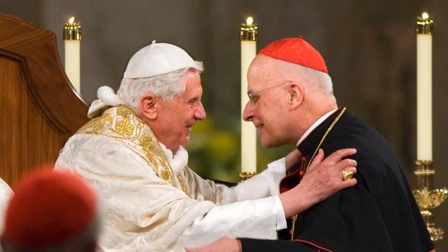 FILE -- In this April 16, 2008 file photo Pope Benedict XVI embraces Chicago's Cardinal Francis George after addressing the bishops at the Basilica of the National Shrine of the Immaculate Conception in Washington. Cardinal Francis George, a vigorous defender of Roman Catholic orthodoxy who played a key role in the church's response to the clergy sex abuse scandal, has died. He was 78. (AP Photo/J. Scott Applewhite)