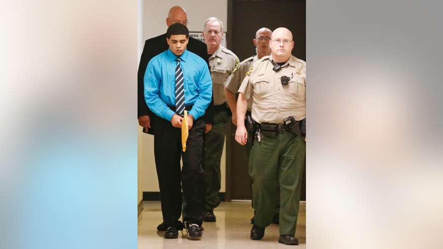 Chancey Luna is led from the courtroom to the jail in shackles and handcuffs after being convicted in the death of Christopher Lane in Duncan, Okla, Friday, April 17, 2015. (AP Photo/Sue Ogrocki)