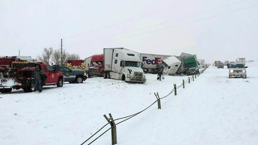 April 16, 2015: Photo released by the Wyoming Highway Patrol shows a vehicle pileup west of Cheyenne, Wyo.