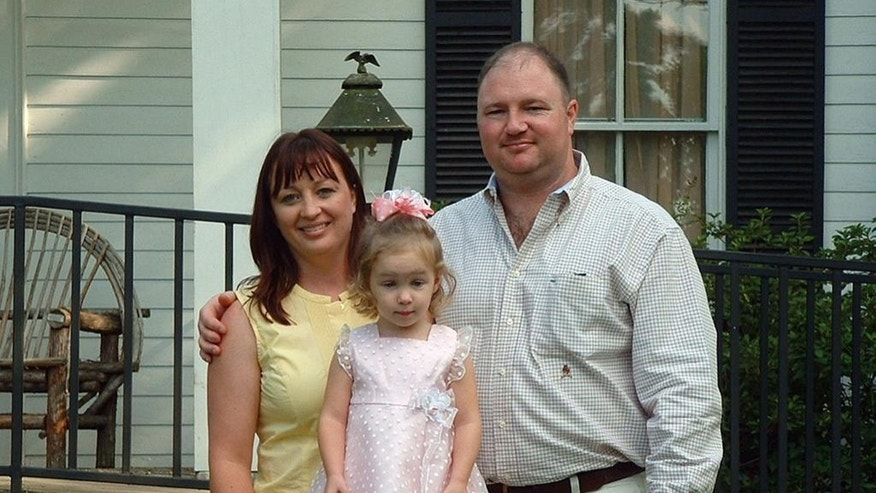 "This undated photo provided by Shelley Anderson shows her with her husband, Jason, and their daughter, Lacy. Jason, 35, was killed in the April 20, 2010 Deepwater Horizon oil rig explosion. He wasn't even supposed to be on the Deepwater Horizon that day. Anderson had been with the rig since it launched from a South Korean shipyard in 2001. By 2010, the Bay City, Texas, man had risen to senior tool pusher, akin to a foreman on a construction site. Anderson was transferring to another rig, and went out to the Deepwater Horizon to train his replacement, says his widow, Shelley. When he arrived, the trainee wasn't there, but Jason stayed over to clean out his locker and spend just a little more time with his ""rig brothers."" (Courtesy of Shelley Anderson via AP)"