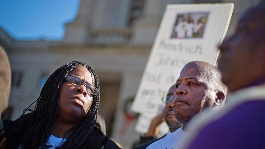 "Dec. 11, 2013: In this file photo, Jacquelyn Johnson, left, stands next to her husband Kenneth, right, at a ""Who Killed K.J."" rally in memory of their son, Kendrick Johnson in Atlanta."