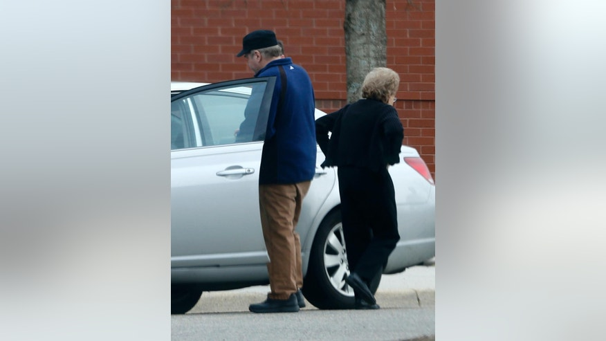 CORRECTS SPELLING OF HINCKLEY - In this photo taken March 19, 2015, John Hinckley gets into his mother's car in front of a recreation center  in Williamsburg, Va. The last man to shoot an American president now spends most of the year in a house overlooking the 13th hole of a golf course in a gated community. He takes long walks along tree-lined paths, plays guitar and paints, grabs fast food at Wendy's. He drives around town in a silver Toyota Avalon, a car that wouldn't attract a second glance. Often, as if to avoid detection, he puts on a hat or visor before going out. These days, John Hinckley Jr. lives much of the year like any average Joe: shopping, eating out, watching movies at Regal Cinemas. (AP Photo/ Steve Helber)