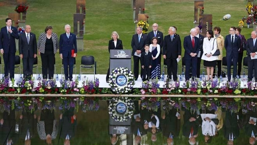April 19, 2015: Speakers, including former President Bill Clinton, fourth from left, stand at the opening of ceremonies to commemorate the 20th anniversary of the Oklahoma City bombing, at the Oklahoma City National Memorial, in Oklahoma City.