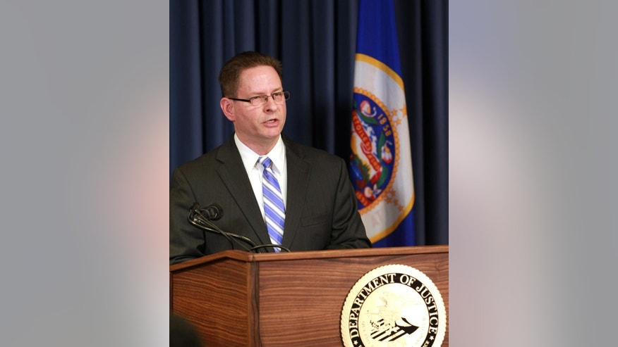 FBI special agent Richard Thornton explains the criminal complaint charging six Minnesota men with terrorism at a news conference in Minneapolis, Monday April 20, 2015. The six, whom authorities described as friends who met secretly to plan their travels, are accused of conspiracy to provide material support and attempting to provide material support to a foreign terrorist organization. The complaint says the men planned to reach Syria by flying to nearby countries from Minneapolis, San Diego or New York City, and lied to federal investigators when they were stopped. (AP Photo/Andy Clayton-King)