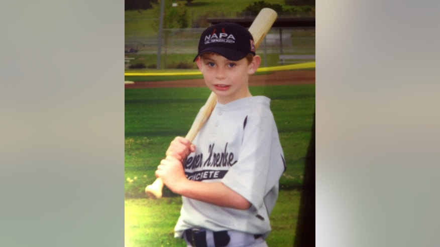 This undated photo provided by the Fairfield Police Department shows 8-year-old Brock Guzman. Guzman, snoozing in the backseat of his family's running car, appears to have slept through his brief kidnapping Monday, April 20, 2015, after the vehicle was stolen in front of his Northern California home, police said. Guzman was found safe about 2 miles away in the abandoned car following an hourslong search. (Fairfield Police Department via AP)