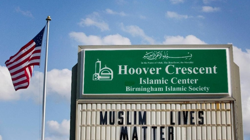 "A sign is displayed outside at the Hoover Crescent Islamic Center that says ""Muslim Lives Matter,"" Monday, April 20, 2015, in Hoover, Ala. A spokesperson for a Muslim family in Alabama has confirmed the family's daughter has fled a Birmingham suburb to join Islamic State militants in Syria after being recruited over the Internet. (AP Photo/Brynn Anderson)"