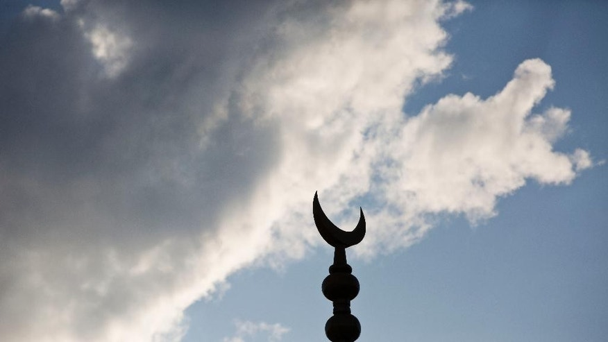 A crescent moon sits atop the Hoover Crescent Islamic Center where a spokesperson for a Muslim family in Alabama has confirmed the family's daughter has fled a Birmingham suburb to join Islamic State militants in Syria after being recruited over the Internet, Monday, April 20, 2015, in Hoover, Ala. (AP Photo/Brynn Anderson)