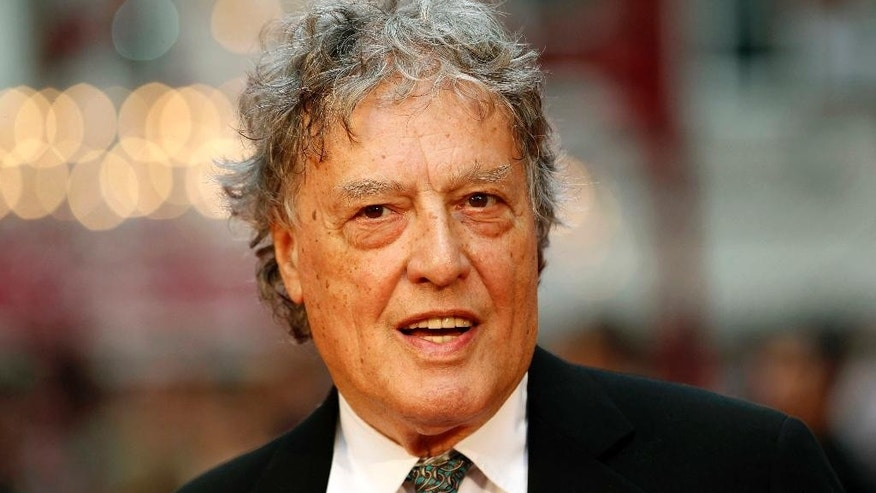 "FILE - In this Sept. 4, 2012 file photo, British playwright Tom Stoppard poses as he arrives for the world premiere of ""Anna Karenina,"" in London. Stoppard is to accept the PEN/Allen Foundation Literary Service Award, the highest honor bestowed by the American chapter of the global human-rights organization of writers and editors. (AP Photo/Sang Tan, File)"