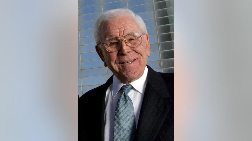 Feb. 9, 2006: In this file photo, Robert H. Schuller poses outside the Crystal Cathedral in Garden Grove, Calif.