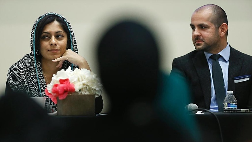 In this March,  27, 2015 photo, Tanzila Ahmed, left, Voter Engagement Manager for the Civic Engagement Project, and Haroon Manjlai, Public Affairs Coordinator, Council on American-Islamic Relations of Los Angeles participate in a discussion on American Muslims and civic engagement from the local to the national level, at the Islamic Center of San Gabriel Valley in Rowland Heights, Calif. The Obama administration has launched a pilot program in several cities charged with tackling global terrorism on a local scale by preventing radicalization from taking root. If the efforts are successful, they would be rolled out nationwide. (AP Photo/Christine Cotter)