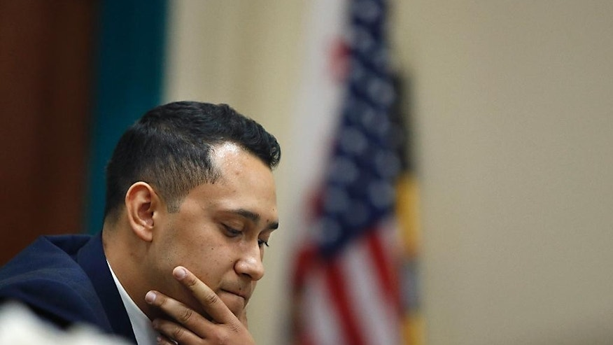 In this March,  27, 2015 photo, Ali Jakvani, Chairman of the Young Muslim Leader Advisory Council, listens during a program on American Muslims and civic engagement from the local to the national level, held at the Islamic Center of San Gabriel in Rowland Heights, Calif. Jakvani was one of the delegates of the White House CVE Summit. (AP Photo/Christine Cotter)