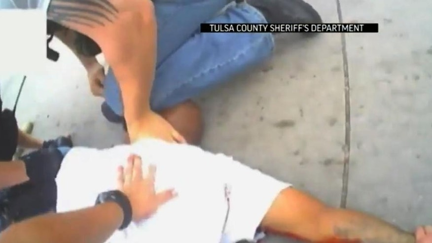 FILE - In this file screen shot from April 2, 2015 video provided by the Tulsa County Sheriff's Office, police restrain 44-year-old Eric Harris after he was chased down and tackled by a Tulsa County Deputy, and then shot by a reserve sheriff's deputy while in custody, in Tulsa, Okla. The sheriff's office said 73-year-old reserve deputy Robert Charles Bates fired the shot that killed Harris, believing he was using his stun gun instead of his service weapon when he opened fire. (Tulsa County Sheriff's Office via AP, File)