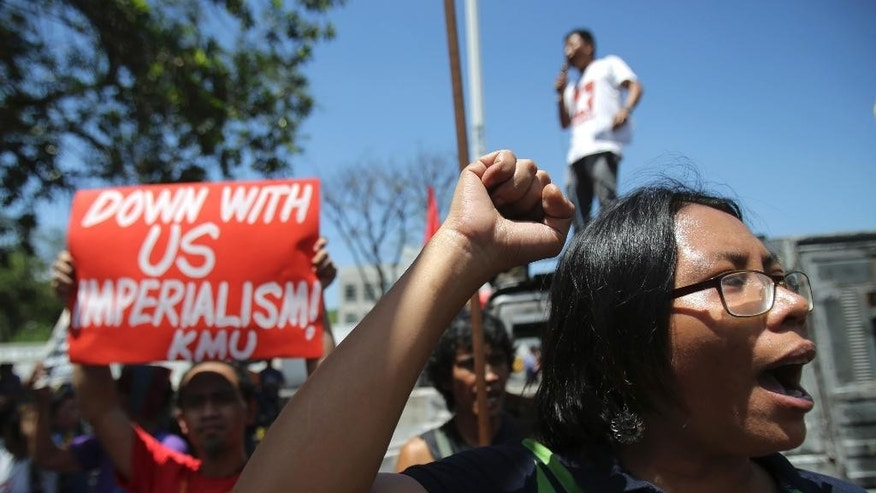 "Filipino activists shout slogans during a rally in front of the U.S. embassy in Manila, Philippines on Monday, April 20, 2015. The group is protesting against a joint U.S.-Philippines military exercise dubbed ""Balikatan 2015"" where troops from both countries take part in an annual drill that focuses on regional security, terrorism, disaster preparedness and inter-operability. (AP Photo/Aaron Favila)"