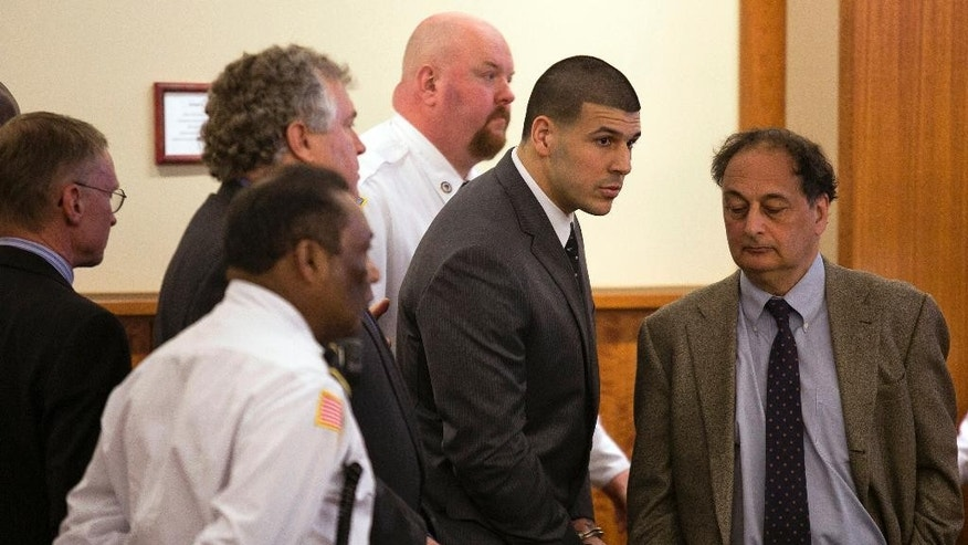 Former New England Patriots football player Aaron Hernandez stands up after he is sentenced to life in prison at his murder trial at the Bristol County Superior Court in Fall River, Mass., on Wednesday, April 15, 2015.  Hernandez was found guilty of first-degree murder in the shooting death of Odin Lloyd in June 2013.   (Dominick Reuter/Pool Photo via AP)