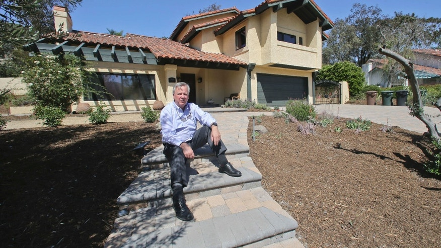 April 17, 2015: Jim Reardon, who is awaiting a ruling from a California appeals court regarding his suit over tiered water rates, stands outside his home where he installed drought-tolerant landscaping in San Juan Capistrano, Calif.