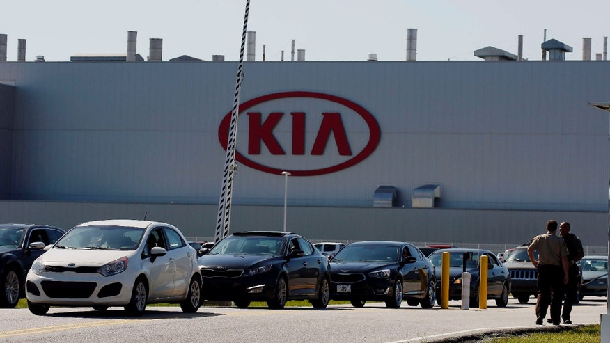 April 21, 2015: Authorities investigate after a shooting at a Kia Motors automobile plant