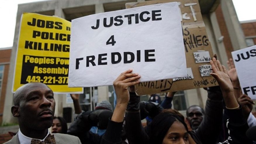 April 21: Protestors stand outside of the Baltimore Police Department's Western District police station during a march and vigil for Freddie Gray.
