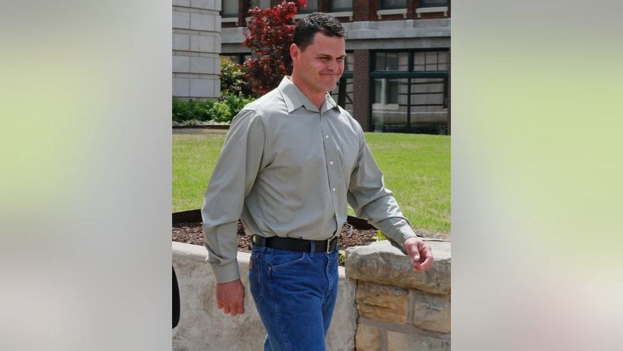 Eric Roberts, an ex-Oklahoma Highway patrolman who's accused of sexually assaulting several women while on duty, leaves the Creek County courthouse in Sapulpa, Okla., Wednesday, April 22, 2015. His preliminary hearing on rape charges has been continued to Friday, June 5, 2015. (AP Photo/Sue Ogrocki)