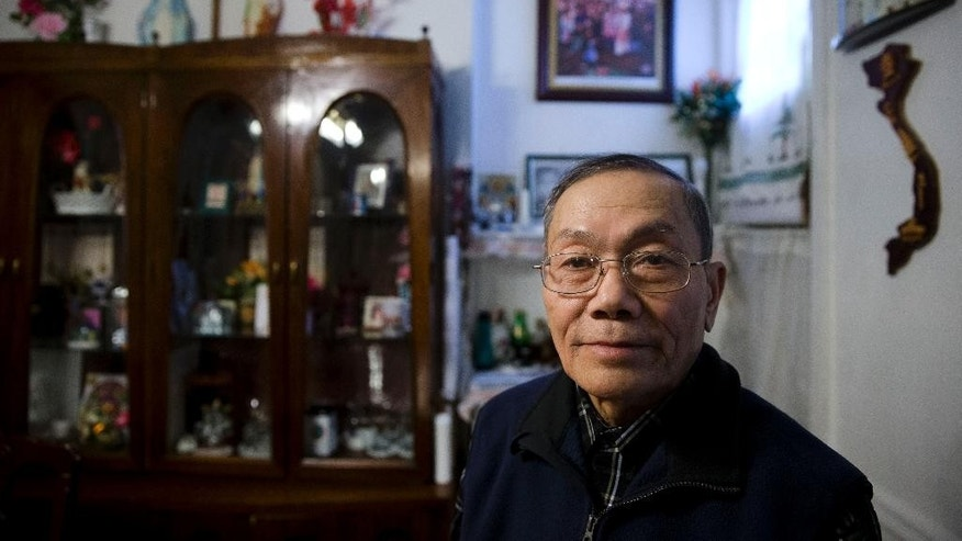 In this Thursday, April 16, 2015 photo, Vietnamese American Catholic Ly Nguyen poses for a photograph at his home in Philadelphia. Nguyen and his family moved to Philadelphia from Vietnam more than 20 years ago and was welcomed and helped by the local Catholic church. (AP Photo/Matt Rourke)