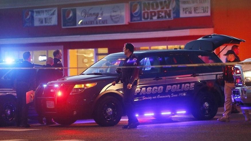 FILE - In this Feb. 10, 2015, file photo, Pasco Police officers investigate the scene of the shooting of Antonio Zambrano-Montes, who was shot by police in Pasco, Wash. Reports about Zambrano-Montes' interactions with police, obtained by The Associated Press through a public records request, provide new details about his behavior and the extent to which the Pasco Police Department was aware of his issues. (Andrew Jansen/Tri-City Herald via AP, File)