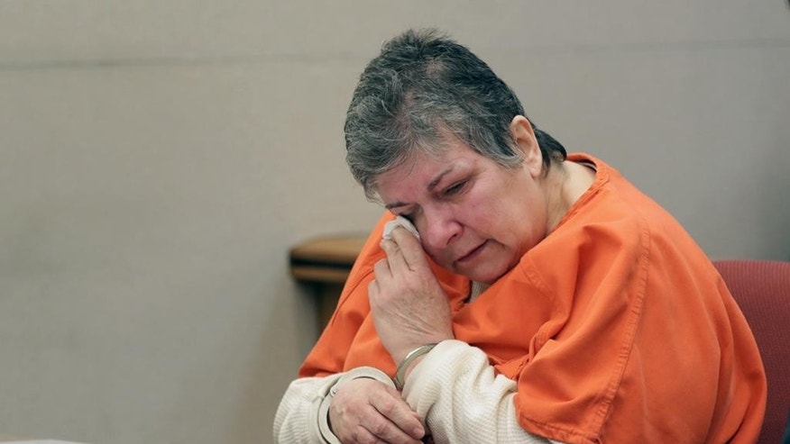 Loretta Burroughs wipes away tears during her sentencing in New Jersey Superior Court in Mays Landing, Wednesday April 22, 2015. Burroughs received a term of 55 years in prison for murder and other crimes in the killing of her husband Danny, whose dismembered remains she hid in plastic storage containers and took with her when she moved.  (Michael Ein/The Press of Atlantic City via AP, Pool)