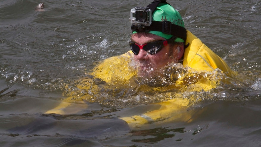 April 22, 2015: Clean-water advocate Christopher Swain swims in the Gowanus Canal in the Brooklyn borough of New York.