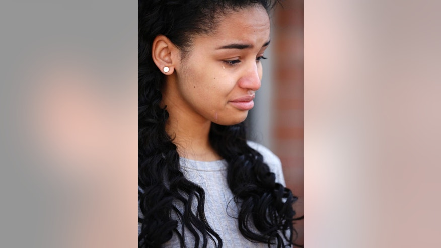 Ariana Mason cries during a news conference Thursday, April 23, 2015, in Las Vegas. Mason is suing Las Vegas police and an officer she says smashed her face into a glass topped table during her arrest during a scuffle last August at a Strip resort nightclub. The excessive force lawsuit says Mason suffered broken teeth and facial gashes from broken glass. The lawsuit concedes that she punched the officer, but it alleges he didn't initially identify himself. (AP Photo/John Locher)