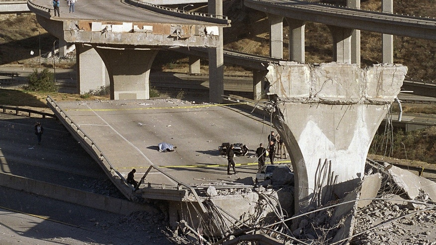 Jan. 17, 1994: The covered body of Los Angeles Police Officer Clarence Wayne Dean, 46, lies near his motorcycle which plunged off the State Highway 14 overpass that collapsed onto Interstate 5, after a magnitude-6.7 Northridge earthquake.