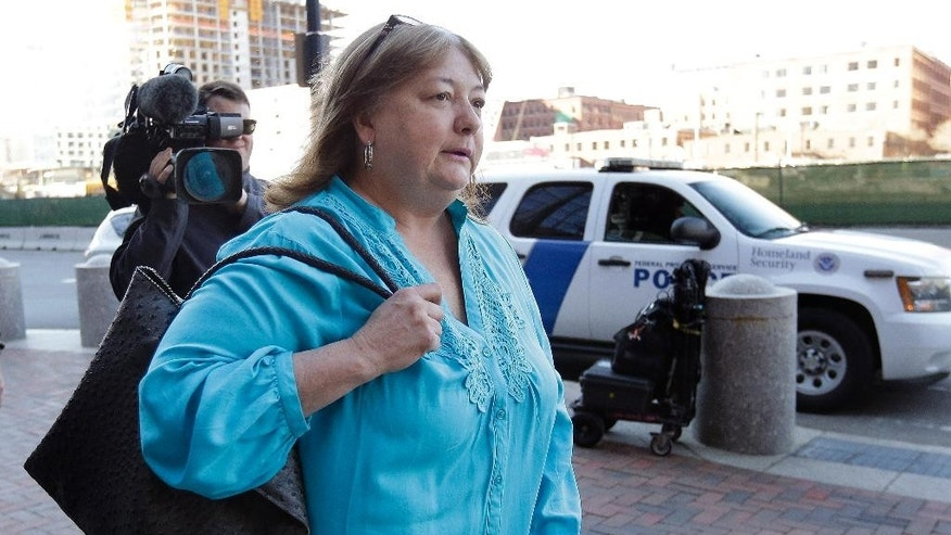 Liz Norden, who had two sons lose legs in the 2013 Boston Marathon bombing, arrives at federal court, Thursday, April 23, 2015, in Boston. The trial for convicted Boston Marathon bomber Dzhokhar Tsarnaev is in the penalty phase. (AP Photo/Steven Senne)