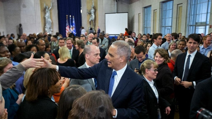 Attorney General Eric Holder bids goodbye to Justice Department employees as he leaves the Justice Department  in Washington, Friday, April 24, 2015, for the last time as attorney general.  (AP Photo/Manuel Balce Ceneta)