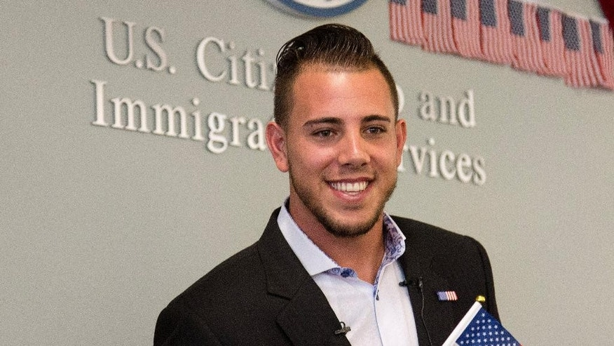 Miami Marlins pitcher Jose Fernandez smiles after becoming a U.S. citizen during a naturalization ceremony Friday, April 24, 2015, in Miami. (AP Photo/J Pat Carter)