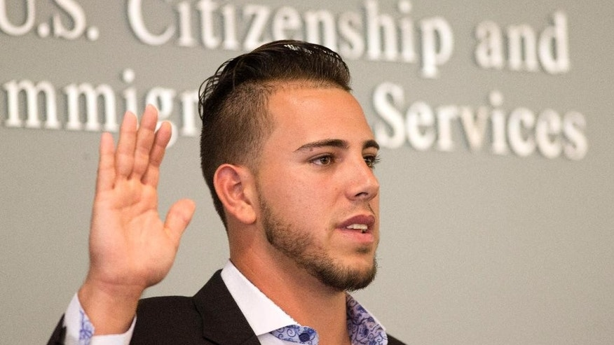 "Miami Marlins pitcher Jose Fernandez takes the ""Oath of Allegiance"" as he becomes a U.S. citizen during a naturalization ceremony Friday, April 24, 2015, in Miami. (AP Photo/J Pat Carter)"