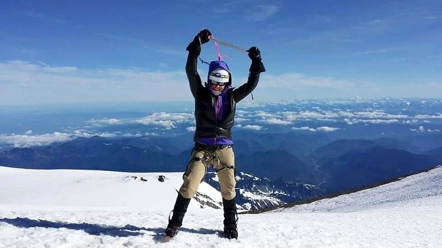In this July 2014 photo released by Mission Memorial Day and Josh Jespersen, Margaux Mange poses for a photo on Mt. Rainier, Wash. Mange is one of four military veterans who are aiming to summit North America's tallest mountain, Mount McKinley in Alaska, on Memorial Day. (Mission Memorial Day via AP)