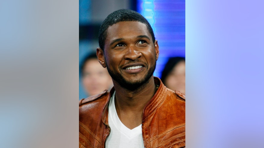 "FILE - In this May 27, 2008 file photo, Usher appears onstage during MTV's ""Total Request Live"" at the MTV Times Square Studios in New York. Anthony Anderson and other celebrities through their foundations teamed up with the United Negro College Fund to donate scholarships to worthy students who are farthing their education. More than $500,000 in scholarships was collectively given to 20 students by Anderson, singers Usher and Toni Braxton, producer Pharrell Williams, comedian Kevin Hart, rapper Big Sean and NBA player Chris Paul. The scholarships on the show were funded by the celebs except for two that were match by the UNCF. (AP Photo/Jason DeCrow, file)"
